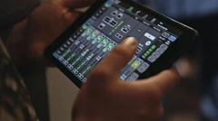 Man working with audio mixer on the tablet Stock Footage