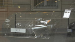People walking and cars driving in front of a car seen through a window, Paris - stock footage