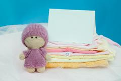 The baby clothes with card - stock photo