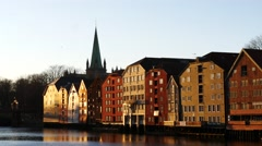 Famous wooden colored houses in Trondheim city, Norway, magic hour Stock Footage