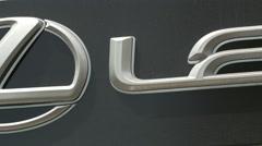 The sign of Lexus Sivam Levallois car dealer on Rue du President Wilson in Paris - stock footage