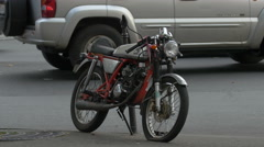 Motorcycle parked on a street in Paris Stock Footage