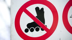 No rollerskates sign on the street Stock Footage