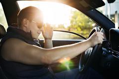 GUY sunglasses DRIVING CAR - stock photo