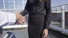 4K Beautiful businesswoman meet & shake hands in urban outdoor area Stock Footage