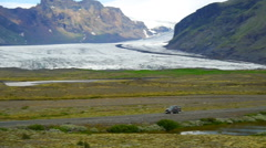 The car goes on the background of the glacier Stock Footage