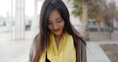 Joyful grinning woman outside in yellow scarf - stock footage