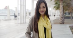 Stylish young woman on a waterfront promenade Stock Footage