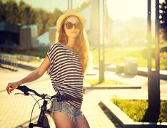Trendy Hipster Girl with Bike in the City - stock photo