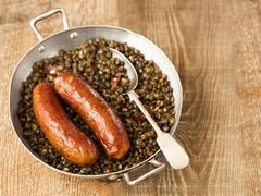 Rustic sausage with lentil Stock Photos