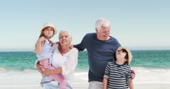 Young kids with grandparents standing Stock Footage