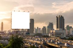 Large blank billboard on building in city view background Stock Photos