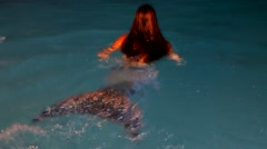 Beautiful woman the mermaid, diving in and floating in water Stock Footage