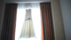wedding dress in front of the window - stock footage