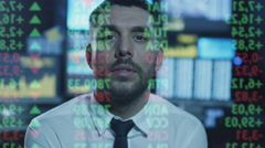 Stockbroker is looking at data with numbers on a transparent glass screen Stock Footage