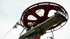 Red chairlift wheel is turning, low shot, close up Stock Footage