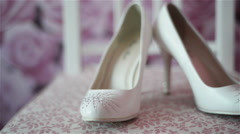 woman wedding shoes on the chair - stock footage