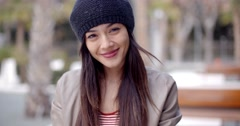 Pretty thoughtful young woman in a woolly cap Stock Footage