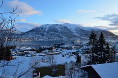 Tromso city in wintertime with snow and sunshine overivew photo february 7th  Stock Photos