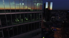 Aerial drone shot of an evening downtown city landscape with glass buildings Arkistovideo