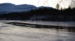 cold icy river stream in wintertime with ice flakes floating down the stream - stock footage