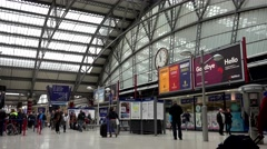 Stock Video Footage of 4K Timelapse tourist people motion central train station hall Liverpool emblem