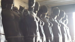 Female armless Mannequins standing on warehouse  Stock Footage
