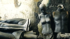 Unfinished male and female mannequins torso in messy warehouse Stock Footage