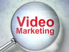 Finance concept: Video Marketing with optical glass Piirros