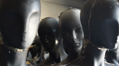 Faceless Mannequins bust, standing, warehouse Stock Footage