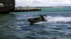 Royal New Zealand navy sailors ride a Zodiak boat Stock Footage