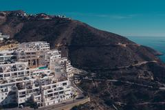 Hillside apartments near the Mediterranean Sea. Alicante, Costa Blanca. Spain - stock photo