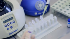 Sample preparation - extraction of DNA from blood samples in a laminar cabinet - stock footage