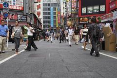 Tokyo, Japan - 19 July 2013.People walking through shopping street - stock photo