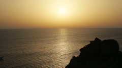 Cruise ship on a clear day with calm seas and sunset sky on the greek island of Stock Footage