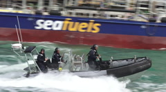 Royal New Zealand navy sailors ride a Zodiak boat Stock Footage