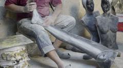 Man worker sanding mannequin leg, messy, dirty workshop Stock Footage