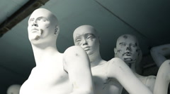 Creepy faces of white nude mannequins, standing in workshop Stock Footage