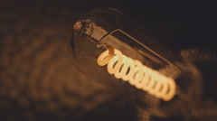 Filament of electric bulb. Real light bulb flickering. Incandescence thread - stock footage