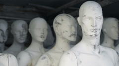 Unfinished male and female white mannequins standing Stock Footage