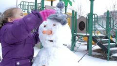 A child making a snowman - stock footage