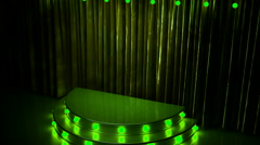 Green curtain stage with golden podium and lights Stock Footage