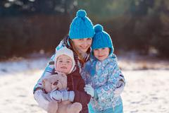 Winter warmth for the whole family - stock photo