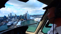 Helicopter pilot fly over Auckland financial center Stock Footage