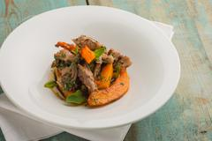 Delicious modern meat stew with pumkin Stock Photos