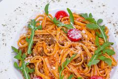 Spaghetti Bolognese with cherry tomatoe, closeup - stock photo