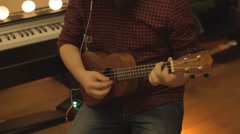 A young boy plays on a beautiful guitar Stock Footage