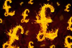 Stock Illustration of Composite image of british pound on fire