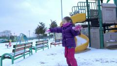 A Child Throwing A Snowball Stock Footage