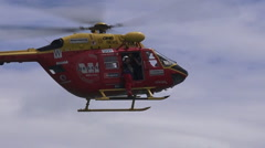 Westpac Rescue Helicopter crew in rescue mission - stock footage
